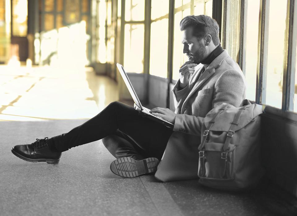 Listening man on laptop
